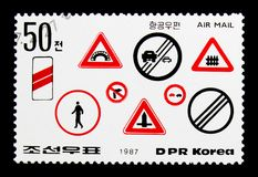 Various roadsigns 2, Road Safety serie, circa 1987. MOSCOW, RUSSIA - NOVEMBER 25, 2017: A stamp printed in Democratic People's republic of Korea shows Various royalty free stock image