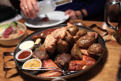 Various roasted meat with sauces Stock Images