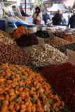 Roasted nuts on a market stall stock photography