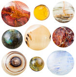 Various round cabochon gem stones isolated. Natural stones - jasper, fire opal, marble onyx, labradorite, selenite, sunstone, banded agate, tourmaline, moonstone stock images