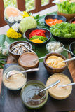 Various salad dressing and fresh vegetable Stock Photography