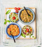 Various salads dish on light rustic background. Home salad bar. Healthy food and vegetarian Eating concept Royalty Free Stock Photos