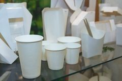 Various samples of disposable tableware in a show-window stock images