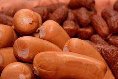 Various sausages - close-up sausages. Two different types of sausages in large quantities - sausages Stock Photo
