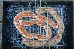 Various sausages on the grill Stock Photo
