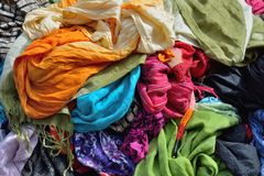 Various scarfs on display , background Royalty Free Stock Photos