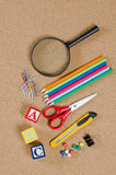 Various school accessories on сorkboard Stock Image