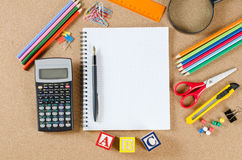 Various school accessories on сorkboard Stock Photography