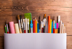 Various school and art supplies, wooden table, copy space Royalty Free Stock Photography