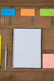 Various school supplies arranged on wooden table Royalty Free Stock Images