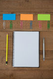 Various school supplies arranged on wooden table Stock Image