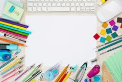 Various school supplies background with white sheet in the middle.  Stock Images