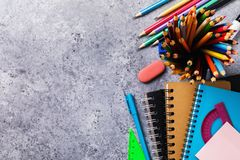 Various school supplies on the desk with copy space. Top view. On pencils, notebooks and rulers stock photos