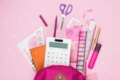 Various school supplies in schoolbag. Close up view of various school supplies in schoolbag Stock Photo