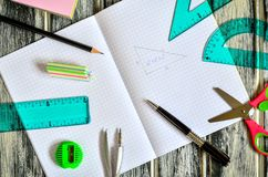 Various school supplies. Notebook and mathematical accessories royalty free stock photo