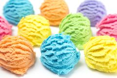 Various Scoops of Rainbow Ice Cream. Scoops of Rainbow Ice Cream on a White Table royalty free stock photos