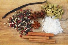 Various seasonings on wooden background Stock Photos