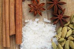 Various seasonings on wooden background Royalty Free Stock Image