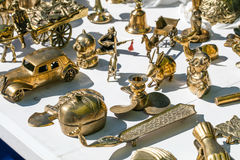 Various second hand brass for collection sold at flea market Stock Photos
