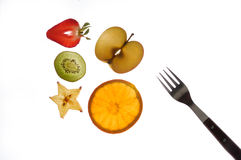 Various sectioned and white fruit, strawberry, kiwi, star fruit, apple Stock Image