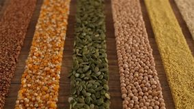 Various seeds and grains arranged in colorful stripes on the table stock footage