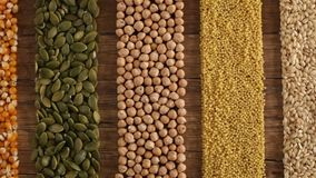 Various seeds and grains arranged in colorful stripes stock footage