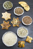 Various seeds in shiny bowls with homemade pastry with seeds Royalty Free Stock Photo
