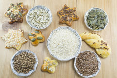 Various seeds in shiny bowls with homemade pastry with seeds Stock Image