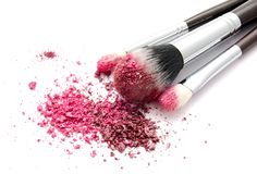 Various set of professional makeup brushes and colourful eye shadows isolated. Over white background stock photography
