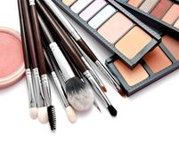 Various set of professional makeup brushes and palette of colourful eye shadows isolated. Over white background royalty free stock photos