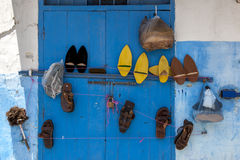Various sets of shoes hanging on a blue doorway at Kasbah des Oudaias in Rabat in Morocco. Stock Images