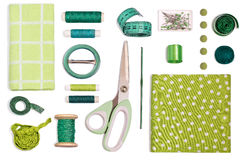 Various sewing accessories and tools green shades Royalty Free Stock Image