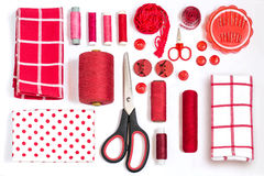 Various sewing accessories and tools red shades Royalty Free Stock Image