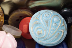 Various sewing buttons set on metal background.   Stock Image