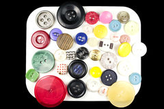 Various sewing buttons with a thread. Isolated Stock Photos