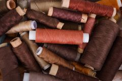 Various shades of brown threads. Various shades of brown sewing thread spools Stock Images