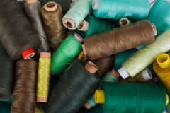 Various shades of green threads. Various shades of green sewing thread spools Royalty Free Stock Images