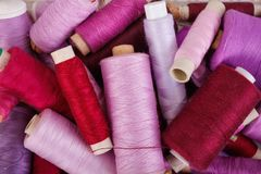 Various shades of purple threads. Various shades of purple sewing thread spools Stock Photos