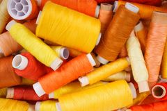 Various shades of yellow threads. Various shades of yellow sewing thread spools Stock Photography