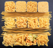 Various shapes of pasta. On a black background Stock Image
