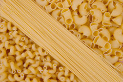 Various shapes of uncooked pasta Stock Photography