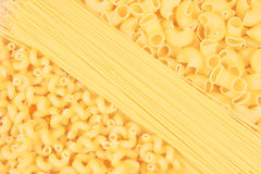 Various shapes of uncooked pasta Royalty Free Stock Photos
