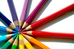 Colored pencils of various colors are making a circle against their heads. Various sharpened pencils are making their heads against each other and making a royalty free stock photography