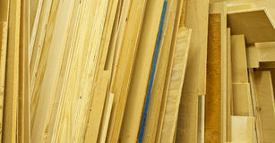 Various Sheets of Plywood Stacked Up. Sheets of various types of plywood & particle board are stacked on end in a woodworkers work shop. Sawdust and cobwebs on Stock Photos