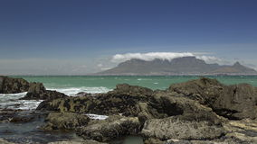 Various shots of waves breaking in front of Table Mountain stock video