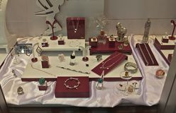 Various silver jewelry on display at exhibition.  Stock Photos