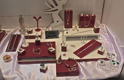 Various silver jewelry on display at exhibition.  Stock Images