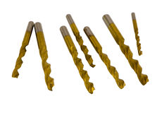 Various size golden drill bits isolated on white Stock Photo