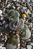 Various size and shape color pebble stones with white streak Royalty Free Stock Photography