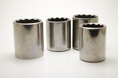 Various size sockets. Various sizes of 12pt sockets usually used to loosen or tighten bolts, and nuts Royalty Free Stock Images